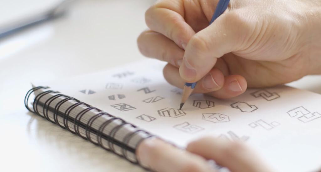 A graphic designer sketch logo ideas