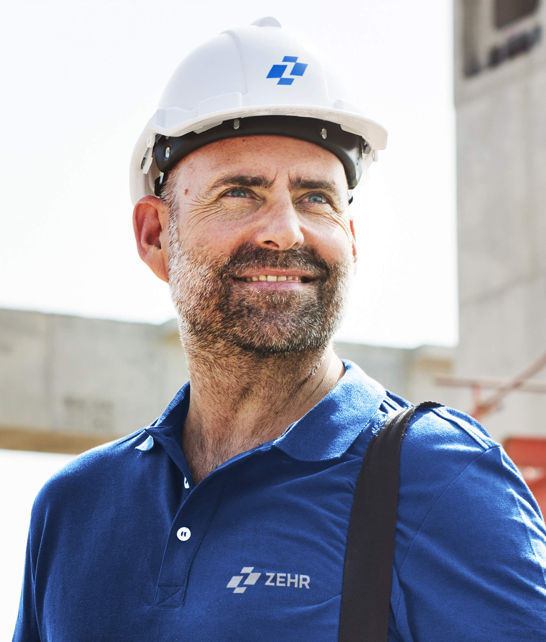 Zehr logo on a hardhat and uniform